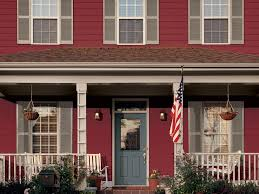 american style home exterior painted in earthy red maroon with
