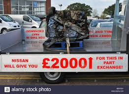nissan cars names nissan car dealer pickup truck carrying a crushed old car as stock