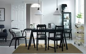 dining room furniture ideas ikea a dining room with a black dining table and chairs combined with a beige trolley