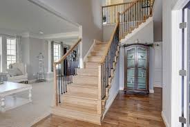lovely wooden staircase with wooden curio cabinetd at the