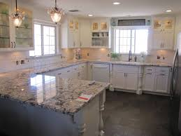 slate backsplash in kitchen blanco antico granite with white cabinets and slate floors