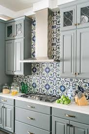 Blue And Gray Kitchen Features Gray Raised Panel Cabinets Adorned - Blue backsplash tile