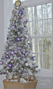 a purple white and silver themed tree silver