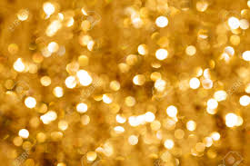 gold blurred light useful as background or greeting