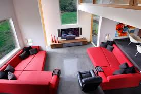 feng shui living room layout with red sofa and contemporary table