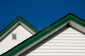 two farmhouse two farmhouse roof peaks against a blue sky stock photo image