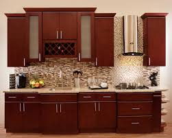 brown polished wooden cherry kitchen cabinet with white countertop