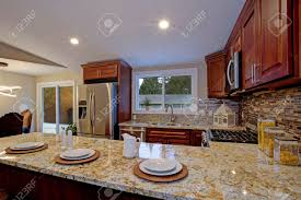 brown kitchen cabinets with backsplash brown kitchen design with mahogany kitchen cabinets breakfast