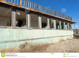 abandoned house with broken windows in bombay beach california