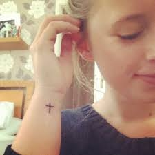 simple cross on right wrist tattooshunt com