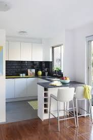 kaboodle kitchen glossy black available at bunnings ushape