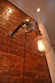 Steampunk Bathroom Fixtures by Bathroom Brick Accent Walls And Wall Sconces With Steampunk