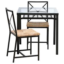 small table with two chairs lerhamn table and 4 chairs black brown ramna beige 118x74 cm ikea