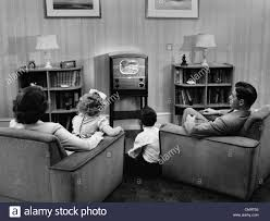 Tv In Living Room 1940s 1950s Family Watching Tv In Living Room Stock Photo Royalty