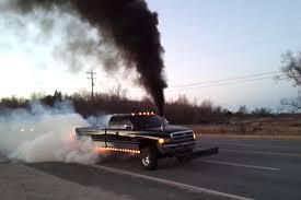 dodge ram smoke stacks 97 dodge ram 2500 shows a doubly smoky burnout diesel army