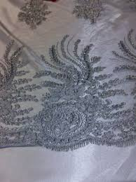 this gorgeous filigree tablecloth or table runner with intricate
