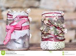 lace home decor jars decorated with roses and lace on a stone background home