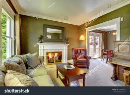 elegant classic green living room fireplace stock photo 123340681