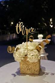 black and gold centerpieces black and gold bridal shower gold glitter jar and gold