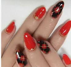 red nail design with geometrical patterns and rhinestones
