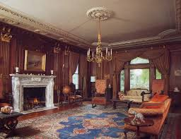 brown wall old house interiors with white fireplace mantle design