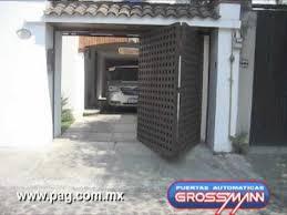 puertas de cocheras automaticas puerta autom磧tica plegadiza hacia afuera 2 m祿dulos