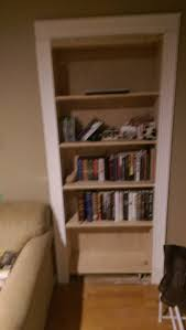 Small Bookcase On Wheels Hidden Pivot Bookcase Installation Thisiscarpentry