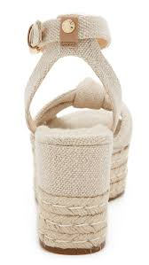 Lyst Michael Michael Kors Maxwell Wedge Sandals In Natural