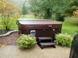 ez pad tub spa base nice surrounding landscaping with the