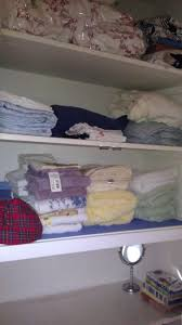 how to organize an overflowing linen closet san diego