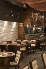 tiger restaurant with wooden wall covering panelling and fish net