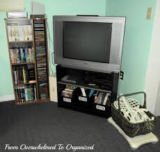 basement entertainment area from overwhelmed to organized