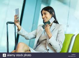 smart traveler images Happy young business traveler taking selfie with smart phone while jpg