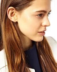 tiny hoop earrings lyst asos tiny hoop earrings in metallic
