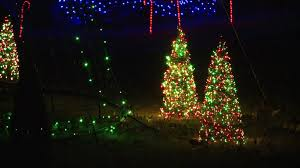 listen to the christmas lights on versailles drive in huntsville