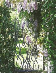 forged steel and blown glass garden or yard sculpture by artist