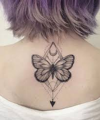 lovely geometric butterfly tatto design on back for