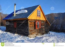 small cabin in the mountains at winter stock photos image 28459513
