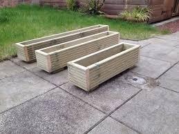 wooden decking planter window box trough garden herb flower in