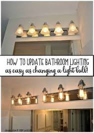 How To Update Bathroom Lighting It S As Easy As Changing A How To Replace A Bathroom Light Fixture