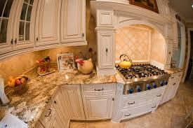 luxury kitchen style with brown tumbled stone tile backsplash