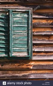austria timber house window with shutters stock photo royalty