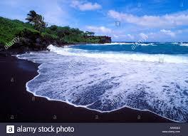 black sand beach hawaii black sand beach and surf at waianapanapa state park near hana