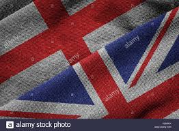 3d rendering of the flags of uk and england on woven fabric