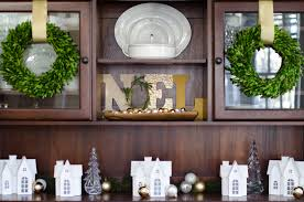 christmas tour 2016 living room and dining room the chronicles christmas dining room with boxwood wreaths noel display and a christmas village scene
