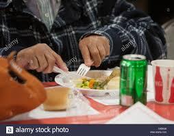 of elderly uses plastic utensils to eat free