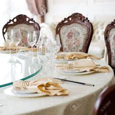 formal dining room table and chairs set for dinner stock photo