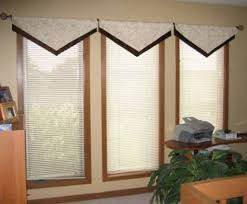 tall windows with triangle valances creating stylish triangle