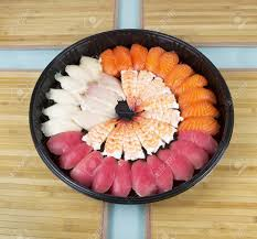 large plastic table mats assortment of fresh sushi placed neatly in a large plastic plate