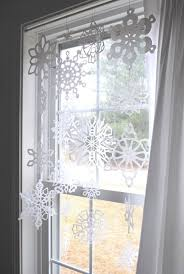 Decorate Room With Paper Let It Snow 15 Ways To Decorate With Paper Snowflakes Brit Co